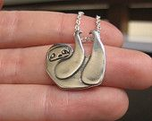 Little Sloth necklace. $26.00, via Etsy....I need this!