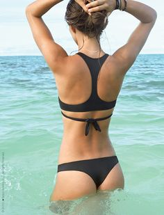 Perfect for the beach-goer who wants edge and sexiness in her bikini top, the L*Space L*Play Zoe Wrap Bikini Top is a sporty chic update to the widely popular Chloe Wrap Bikini Top! Now featuring a racerback silhouette, this wrap bikini top is known for creating lift and cleavage and is guaranteed to turn heads.