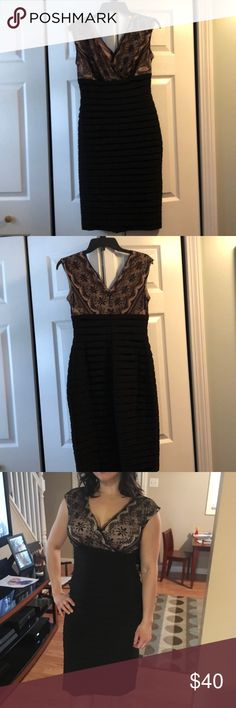 Women's size 6 Dress Barn Dress . Worn once this beautiful detailed dress is great for any occasion. Sexy v neck with detailing on top. Long black seek bottom for added elegance. Dress Barn Dresses