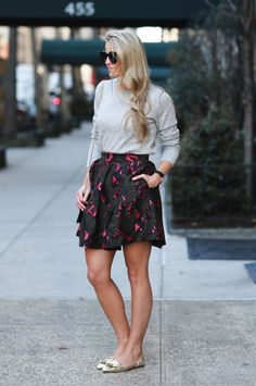 Kendall Kremer is laid back yet sophisticated in our dark green and pink jacquard fit-and-flare skirt with our gray Italian cashmere-blend crewneck sweater and metallic flats | Banana Republic