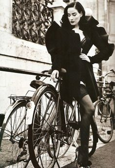 Cycling chic at its best.  Dita Von Teese