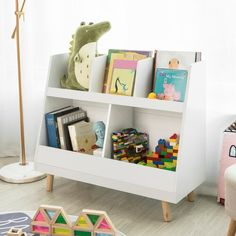 Modern bookshelf design is perfect for a kids playroom. 5 storage bins all at the perfect height for little ones is a great book storage solution. Store books and legos in the different bins.