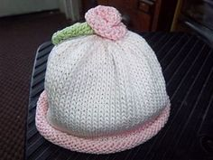 Free Knit Baby Hat Pattern with a rosebud and more free baby hat knitting…