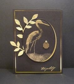 handmade card ... Asian theme ... black and metallic gold ... elegant look ... oval frame with crane ... luv it!
