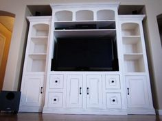 DIY entertainment center... yes yes and yes.. just need to talk matt into doing this lol