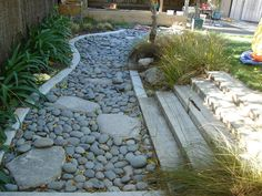 Dry creek bed - maybe we should do something like this were it floods in our yard