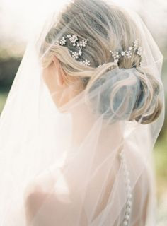 Gorgeous clips under the veil. Stunning!