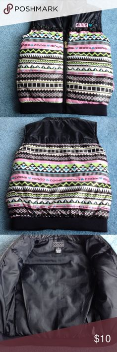 Girls Coogi vest with zip front Zip up vest, side seam pockets, black ribbon detail on front. 100% polyester and gently worn. COOGI Jackets & Coats Vests