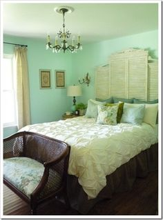 Love the color of the paint and the head board made from reclaimed shutters!
