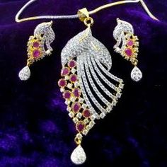 Designer Ruby American Diamond Gold Plated Chain Long Pendant Earring Set Beautifully hand crafted Pendant and Earrings Sparkles like real diamond gold necklace High quality American Diamonds are used Perfect for party look Gold plated pendant set   ₹1,299.00 INR buy at http://crazyberry.in/online-shopping/artificial-imitation-fashion-jewellery/designer-ruby-american-diamond-gold-plated-chain-long-pendant-earring-set