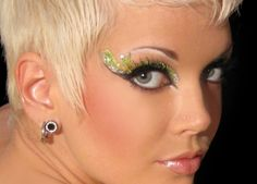 Tink Green Fairy Xotic Eyes - These Tink Xotic Eyes are a lime and electric green swirls with series of tiny and big white rhinestones making a big splash around the outer eye with dots of rhinestones on the inner eye. The bottom strip is a silver dot and a green diamond shape on the outer edge. Perfect for a tinkerbelle Fairy, Mother Nature, or even St. Patrick's day. This is a unique line of Temporary Body Art and Eye Paint. #fairy #peterpan #eyes #makeup #yyc #costume