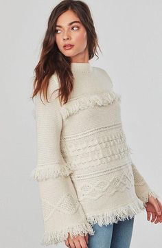 Hey girl, wanna buy some fringe? The Baker is a cable knit sweater with bell sleeves and all the fringe trim your heart desires. Shop BB Dakota now.