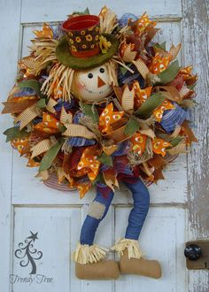 DIY tutorial for wreath made with a scarecrow head, dangling legs, work wreath, frayed edge burlap and ribbons.