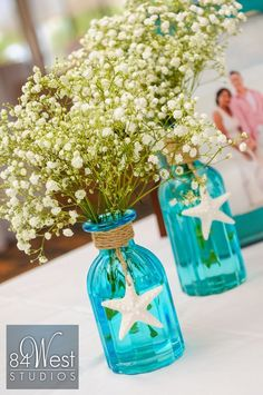 Beautiful beach themed centerpiece using blue mason jars, starfish and baby's breath. Perfect for a beach bridal shower or wedding. BABY'S BREATHS ONLY IDEA Beach Theme Centerpieces, Beach Wedding Decorations, Beach Wedding Favors, Wedding Themes, Wedding Ideas, Beach Weddings, Trendy Wedding, Wedding Blue, Centerpiece Ideas