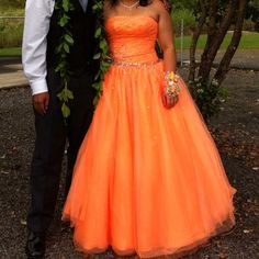 """Tiffany Prom Dress """"Free Shipping"""" Beautiful """"Tiffany"""" Cinderella Prom Dress, tangerine color with sequence on top area and scattered on gown, very flattering style, laced up back. My daughter just loved this dress, she used it once for 4 hours at Prom. Every Princessdeserves a Cinderella Gown Tiffany Dresses Prom"""