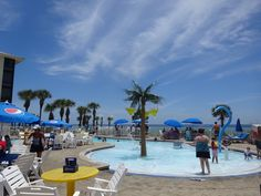 All visitors who dine at Barefoot On The Beach get to use their pool! You can even host parties here! Great outdoor dining spot in Panama City Beach that most don't know about-plus, there is a boardwalk with showers right down to the beach. Panama City Beach, Beach Bars, Outdoor Dining, Barefoot, Showers, Restaurants, Florida, Street View, Parties