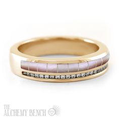 This stunning alternative wedding ring is crafted from mother of pearl with diamonds and is handmade in the United States. Browse our selection of one-of-a-kind wedding rings to find the one for you. | The Alchemy Bench #BridalTransformed