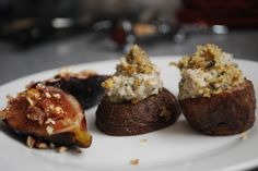 Award winning Vegan appetizers  Roasted purple potatoes with cashew cream, walnut sage crunch topping nd pomegranate glazed grilled figs with pecan topping