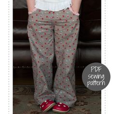 This classic, straight-legged pant (or shorts) is great for everyday play  or for dress-up. The pants have a lowered front waist for a natural and  comfortable fit.  The options that come with this pattern are:  ::front hip pockets with or without ruffles  ::pleated or gathered back pockets  ::shorts for girls and shorts for boys  Sizes included are: Child sizes 2 to 10.  MORE PHOTOS