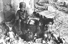 Filipino children homeless amid WWII wreckage, 1945 (2) by John T Pilot, via Flickr