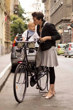 amsterdamcyclechic--Moms and Dads cycling with their kids.  Photos from all over the world.  SUPER cute!