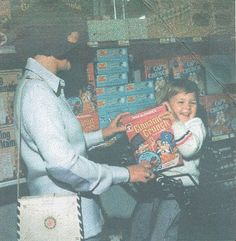 Sorry for the lack of quality, this is a color copy of a photo but I think is worth it for the Cap'n Crunch Cinnamon Crunch and the Vanilly Crunch in the back on the shelves.