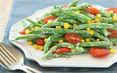 Goat cheese makes a uniquely tangy dressing for crisp-cooked green beans and sweet raw corn kernels.