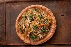 This classic vegetarian japchae recipe is a Korean stir-fry with sweet potato noodles, mushrooms, spinach, and carrots.