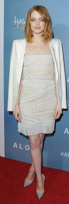 Emma Stone in a white flapper-inspired embellished minidress with a sleek white blazer