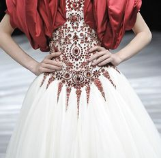 Bead embroidery on bodice of haute couture gown.