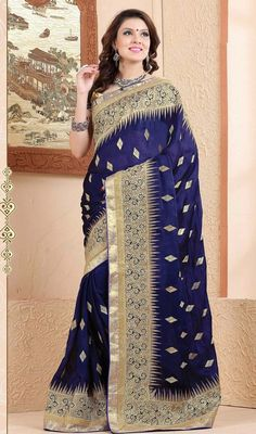Immerse into a refined indulgence dressed in this navy blue embroidered chiffon and satin sari. This attire is beautifully adorned with heavy lace border, jari, diomond and sequins work. #FancyEmbroideredWorkChiffonAndSatinSari