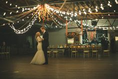 Lighting over dance floor w/ribbons in your colors (reds, purples, emerald green)