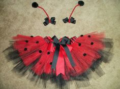 This listing is for a ladybug tutu with matching antenna bows. This tutu has a handsewn double layer bow and handsewn spots. The antenna bows are Ladybug Tutu, Ladybug Girl, Ladybug Costume, Ladybug Party, Costumes Avec Tutu, Up Costumes, Halloween Costumes, Scarecrow Costume, Costume Coccinelle