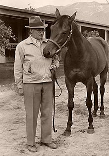 Seabiscuit with trainer Charles Smith;   http://en.wikipedia.org/wiki/Seabiscuit