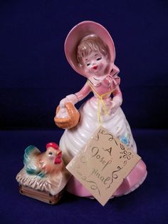 This little lady is out gathering eggs in her pink dress and bonnet and white apron. Her little chicken friend is cute! | eBay!