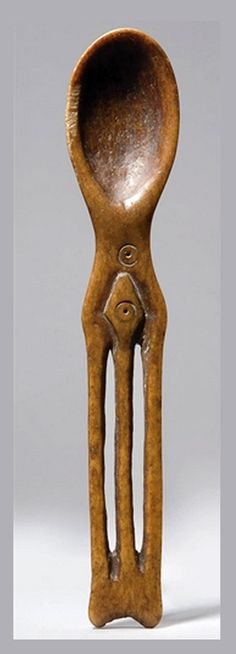 Africa | Spoon from the Lega people of DR Congo | Bone; light to dark brown patina | ca. 1950s