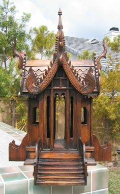 """Spirit house (Item #: shmct022) - Hand carved Square """"Pra Prom"""" Spirit House. Intricately carved in Thailand from teak wood with stair entrance."""