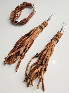JUST IN at www.threeblooms.com Leather earrings and bracelet! Come join the fun! www.threeblooms.com and enter your email address for DEALS!!!! Beaded Earrings, Beaded Jewelry, Handmade Jewelry, Leather Gifts, Leather Craft, Leather Necklace, Leather Jewelry, Jewelry Tools, Jewelry Crafts