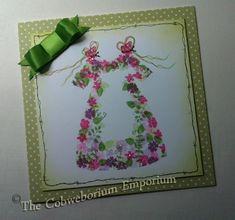 Card-io stamping in shape of dress by Cobweborium Emporium