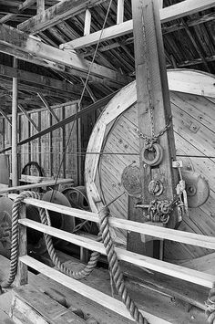 OIL DRILL FLYWHEEL © Trever Miller  A giant flywheel is a key part of a recreation of one of the first oil drilling rigs. Heritage Partk, Calgary, Alberta, Canada.    Prints start at $30