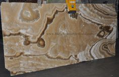 CAPPUCCINO ONYX marble  This natural stone is gorgeous and, looks wonderful after all finishing has been done, Marble can be use as wall cladding, bar top, fireplace surround, sinks base, light duty home floors, and tables.