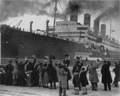 Aquitania is a mammoth next to the people waving to the passengers. Next stop...NEW YORK!