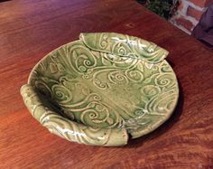 A personal favorite from my Etsy shop https://www.etsy.com/listing/261364365/pottery-textured-bowl-in-green-celadon