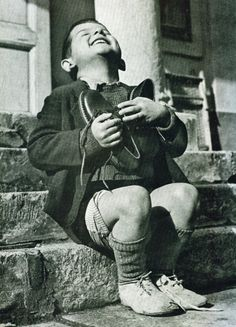 An Austrian boy couldn't be more excited about his first pair of new shoes in years, 1946