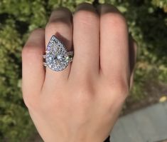 4.01 carat pear shaped / tear drop diamond engagement ring with halo in white gold engagement ring setting from Diamonds Direct #pear #pearshape #teardrop #diamond #engagementring #4carat #halo