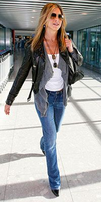 December 5, 2009  Jennifer Aniston in a custom Burberry leather jacket, gray cardigan and Degaine jeans with a bag from Ferragamo
