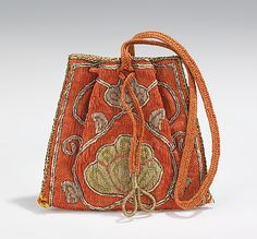 Pouch, late 18th century, Russian, silk, metal. This small ornate bag was likely a gift for social or diplomatic purposes. The quality is evident in the use of precious metals in both the embroidery and woven in the fabric.