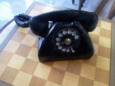 Vintage rotary telephone from the US Army Signal Corps model telephone manufactured between aluminium