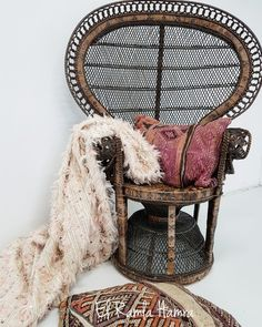 Peacock chair with beautiful Moroccan pillows made from vintage rugs.