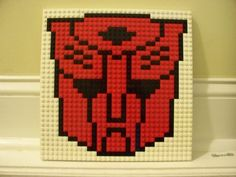 Transformers AUTOBOT Lego Mosaic    This LEGO Mosaic is made of nearly 200 new and used Lego plates.  The work measures appx 10x10  Mounted on an